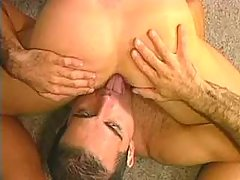 Two attractive guys play twosome blowjob on the floor