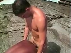 Twink does African boy on sea shore