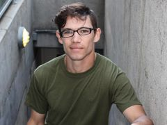 Bud is a lean cut young man wearing glasses which gives off a great sex appeal