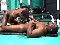 Black fruit sucks chocolate cock in gym