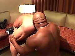 Mature gays have fun in interracial orgy