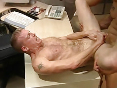 Hairy man gets deep anal penetration on table