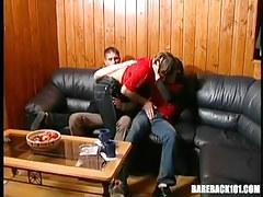 Three teenage gays kiss on leather sofa