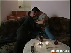 Cute gays kiss each other by candlelight