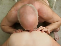 Old bear licks out tasty males hole outdoor