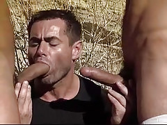 Hungry homo sucks two cocks by turns in desert