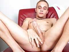 lean tattooed stud jerks off his big cock for the camera