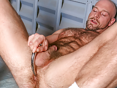 Dirk ploughs over his hairy muscular body & probes his ass