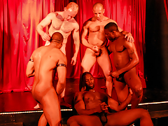 5 sweaty guys rehearse on stage for a live interracial sex show